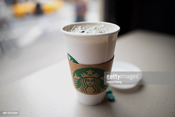A cup of coffee is displayed for a photograph inside a Starbucks Corp location at Union Square in New York US on Tuesday July 21 2015 Starbucks Corp...