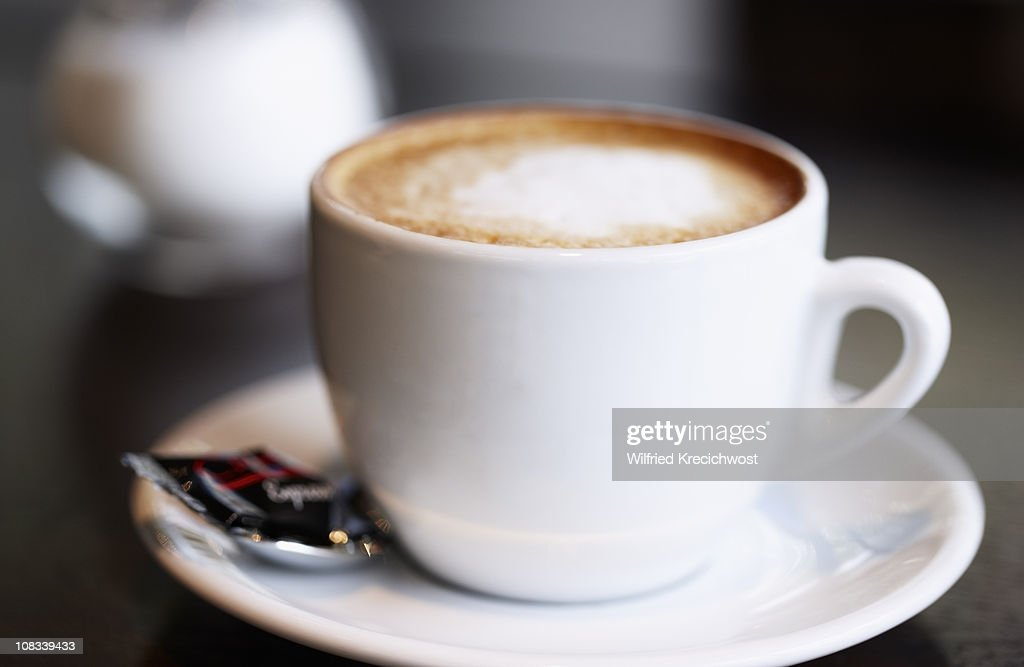 cup of coffee latte on table, close-up : Stock Photo