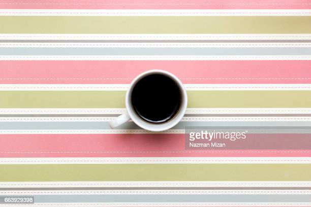 A cup of coffee on colorful background.