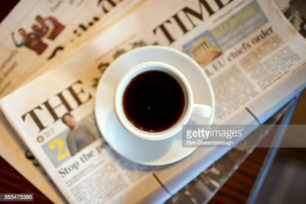 A cup of coffee on newspapers