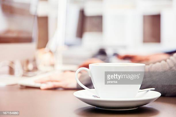 Cup of coffee on office desk