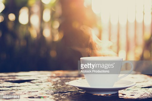 Cup of coffee on old wood table - vintage tone : Stock Photo