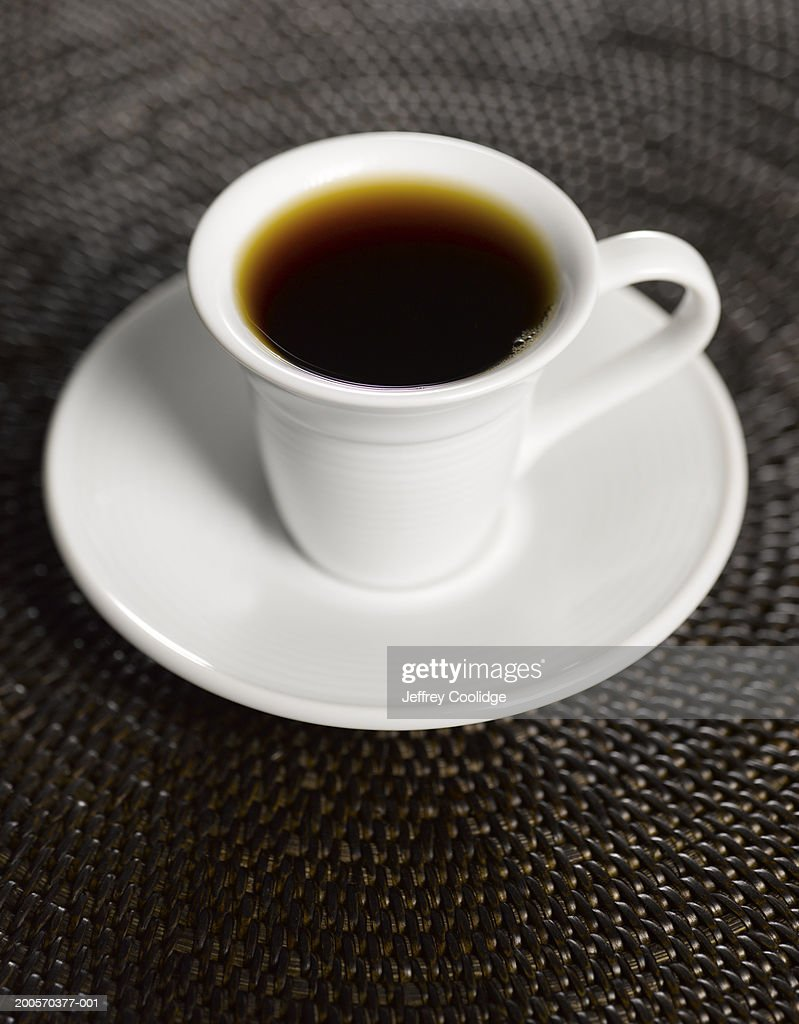 Cup of coffee on placemat  : Stock Photo