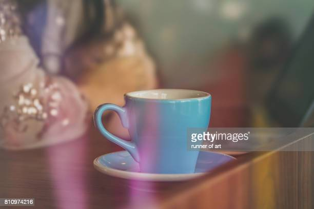 A cup of coffee on table at cafe