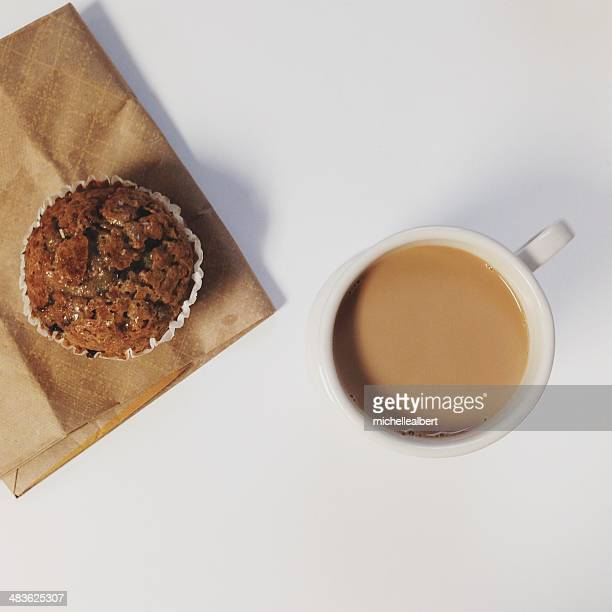 Cup of coffee with a muffin