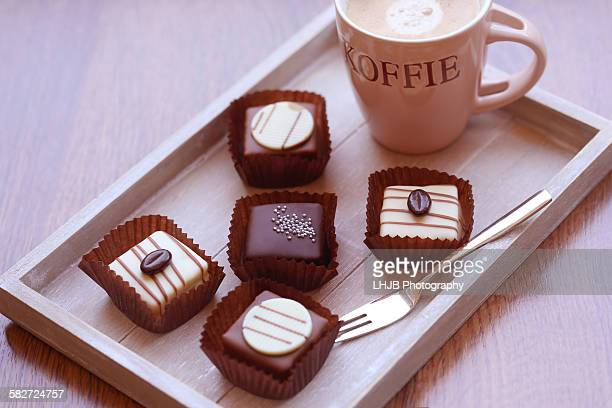 Cup of coffee with chocolate petit fours