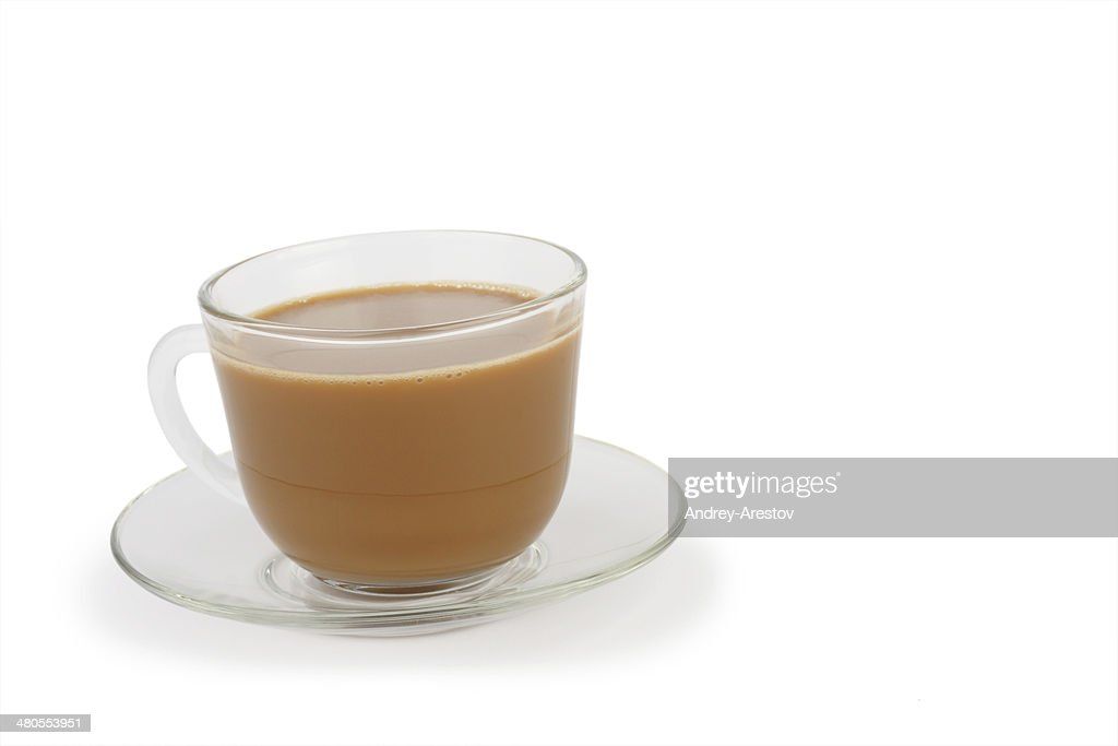 Taza de café con crema y platillo : Foto de stock