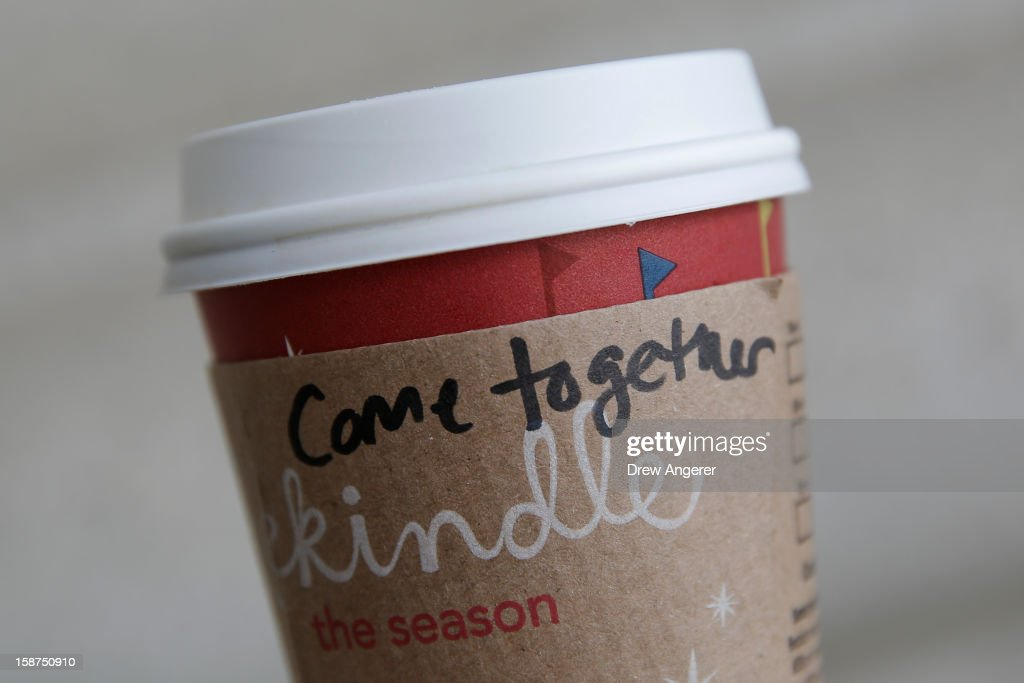 A cup of coffee with the words 'come together' is seen at the Union Station location of Starbucks, on December 27, 2012 in Washington, DC. Starbucks CEO Howard Schultz says the words are intended as a message to lawmakers about the damage being caused by the divisive negotiations over the 'fiscal cliff.'