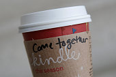 A cup of coffee with the words 'come together' is seen at the Union Station location of Starbucks on December 27 2012 in Washington DC Starbucks CEO...