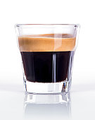 Close up of a glass of espresso on a white background