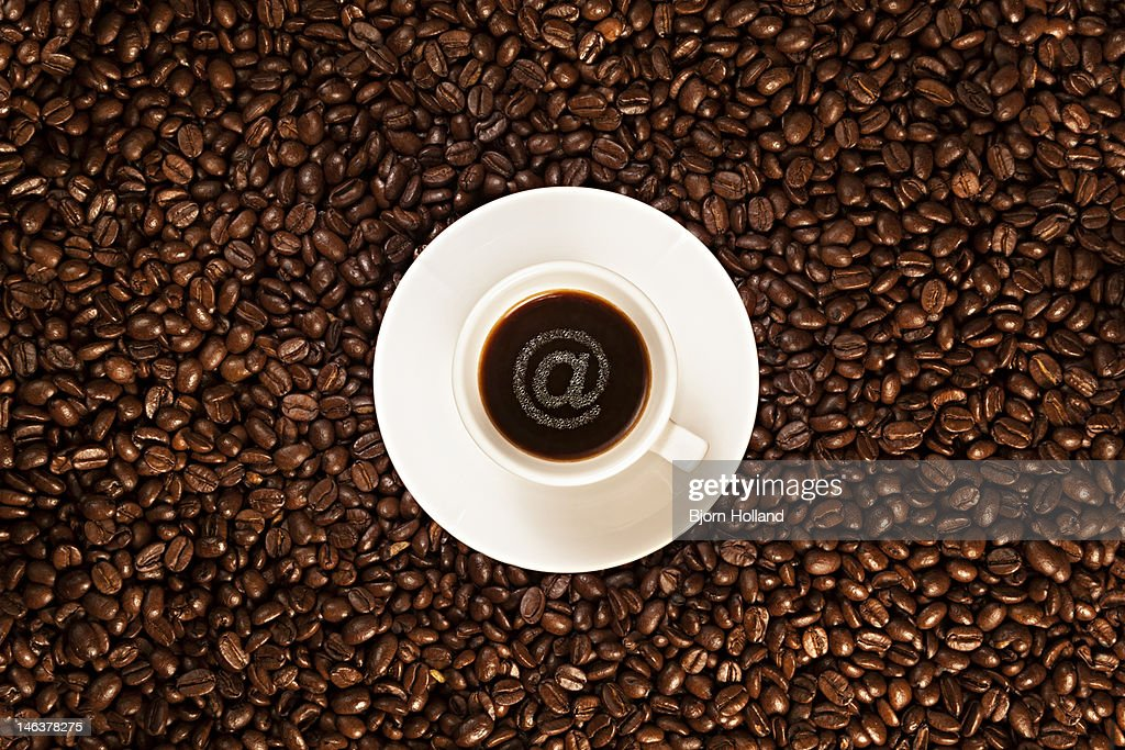 Cup of espresso coffee with @-sign bubbles : Stock Photo