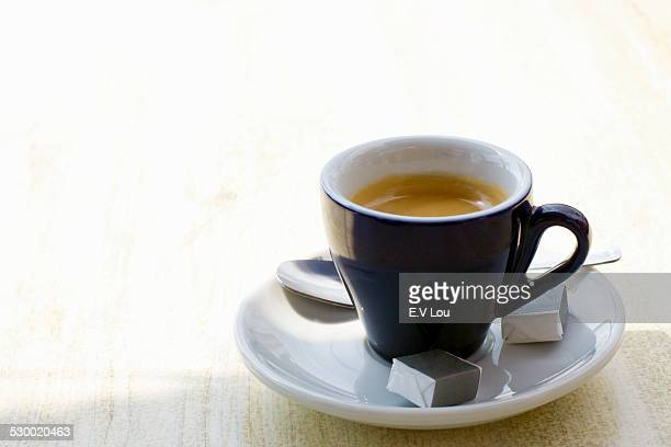 Cup of espresso on cafe table