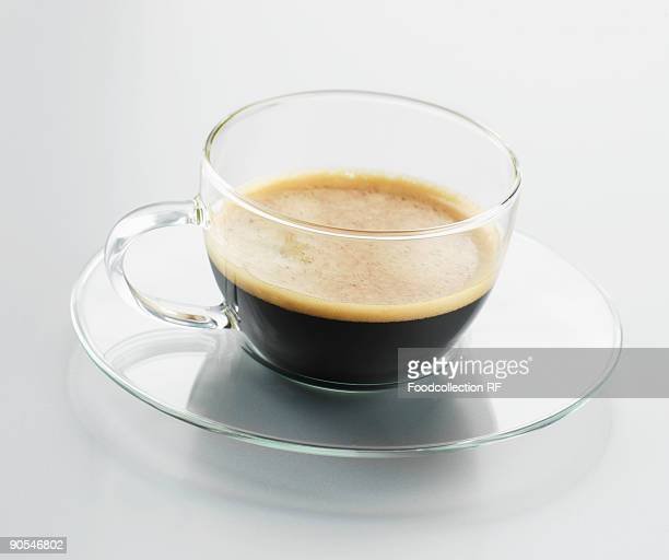 Cup of espresso on white background, close up