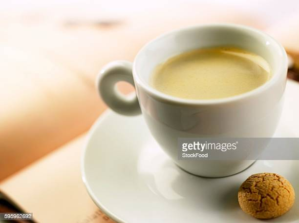 A cup of espresso with almond biscuit