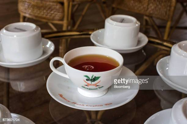 A cup of freshly brewed tea sits on a table at the Geragama Tea Estate operated by Pussellawa Plantations Ltd in Pilimathalawa Central Sri Lanka on...