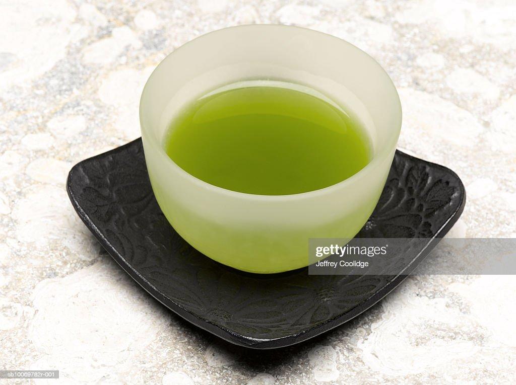 Cup of green tea, studio shot : Stock Photo