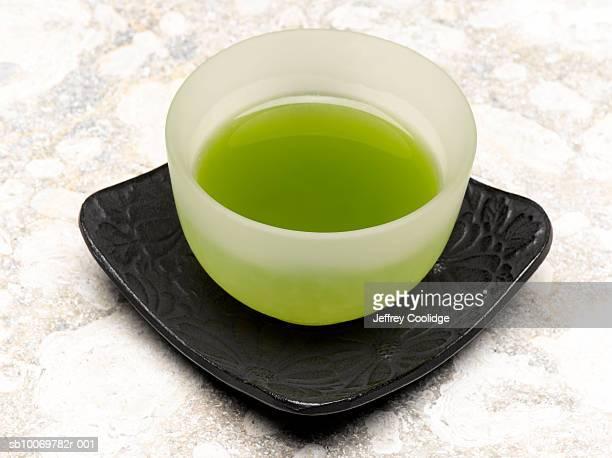 Cup of green tea, studio shot