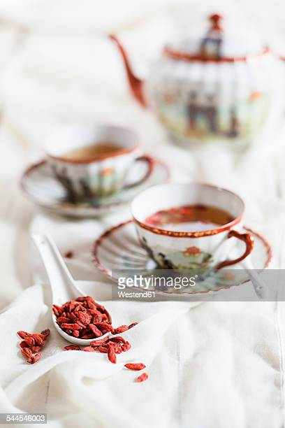 Cup of green tea with dried Goji berries, Lycium barbarum