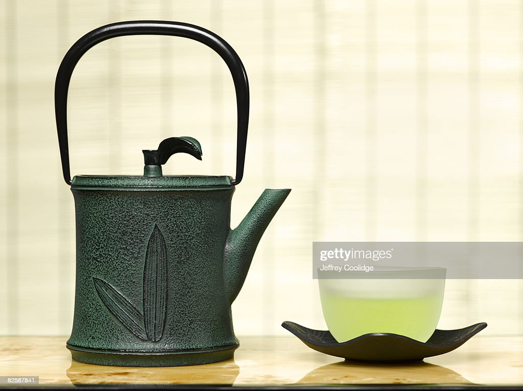 Cup of green tea with teapot : Stock Photo