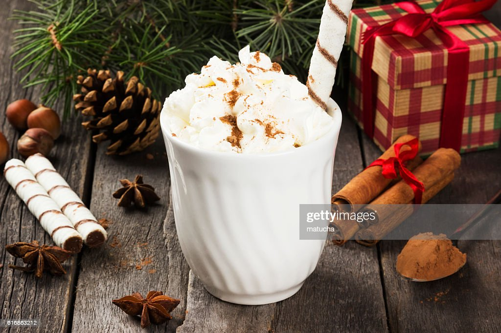 Cup of hot cocoa with cream on a dark background : Stock Photo