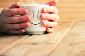 cup of hot tea or coffee in hands. good morning concept