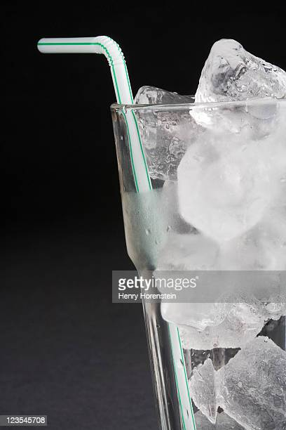 Cup of ice with straw