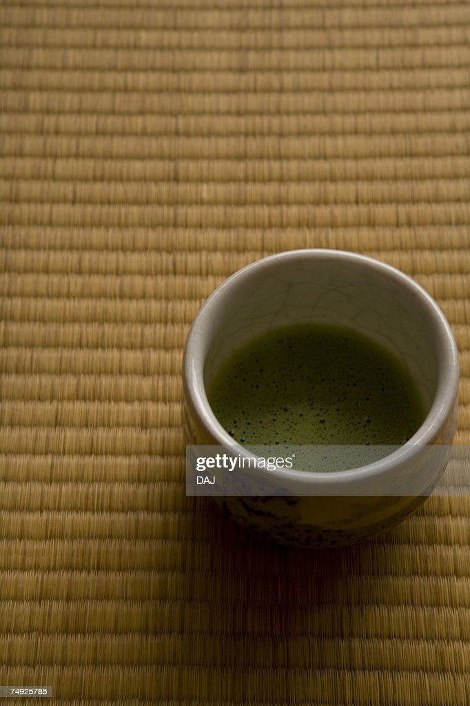 A cup of Japanese tea on a Tatami mat, high angle view, close up, Japan : Stock Photo
