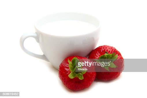 cup of milk and strawberries : Stock Photo