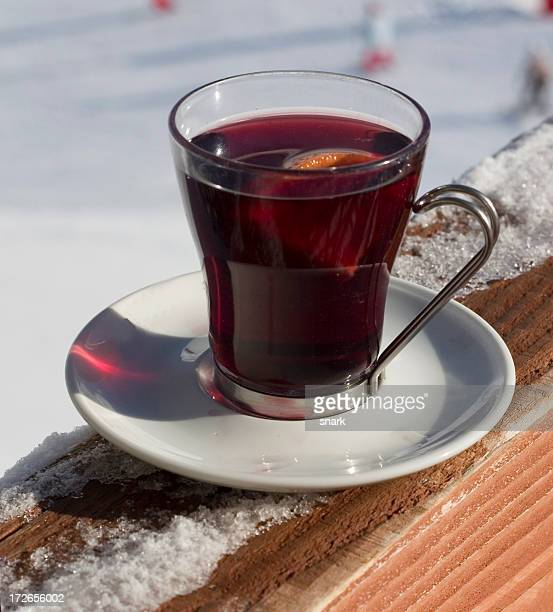 Cup of mulled wine, snow on the background
