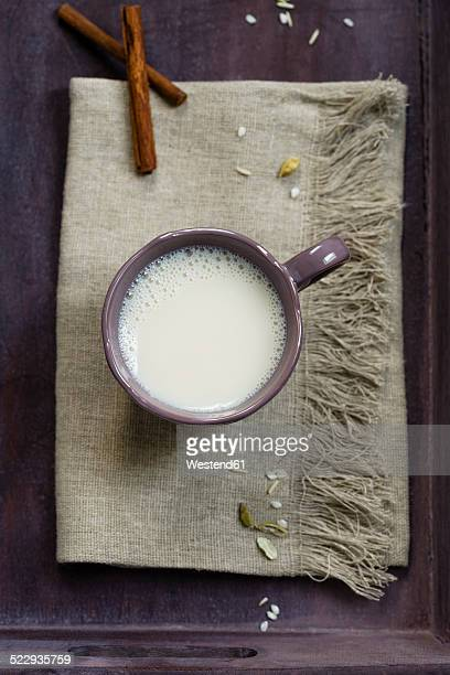 Cup of soy rice milk spiced with cardamom and cinnamon, elevated view
