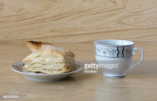 Cup of tea and a puff pastry : Stock Photo