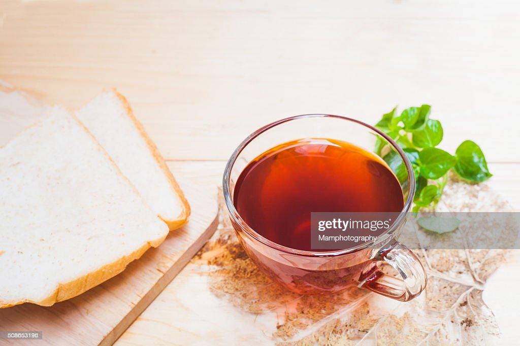 Cup of tea and bread on  white wooden background : Stock Photo