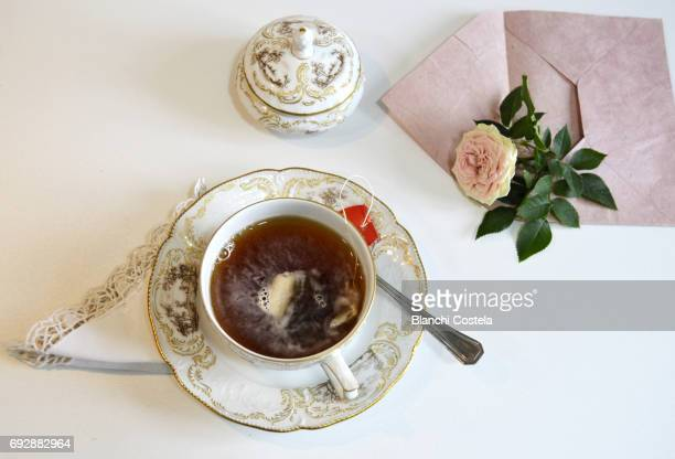 Cup of tea and flower seen from above