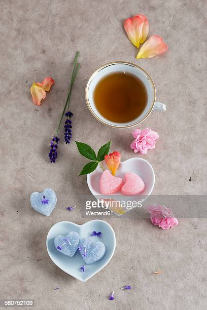 Cup of tea and sugar hearts with taste of roses or lavender