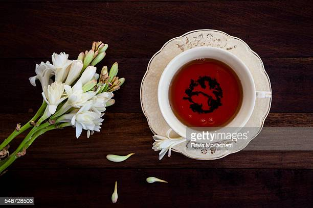 Cup of tea and white flowers