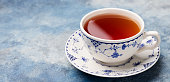 Cup of tea on a blue stone background. Copy space.