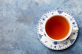 Cup of tea on a blue stone background. Copy space Top view