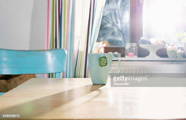 Cup of tea standing on kitchen table