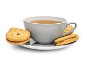 Cup of tea with sandwich cookies on on saucer. Isolated on white.