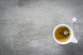 Cup of tea with teabag, on concrete stone background