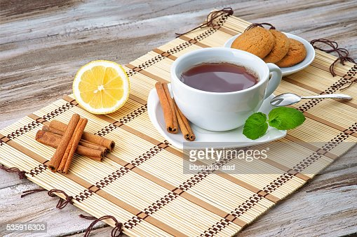 Cup of tea,cookies and lemon : Stock Photo
