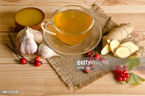Cup of tea,slices of ginger,honey,rosehip berries and viburnum : Stock Photo