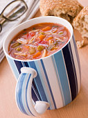 Cup Of Vegetable And Pasta Soup With A Granary Bread Roll