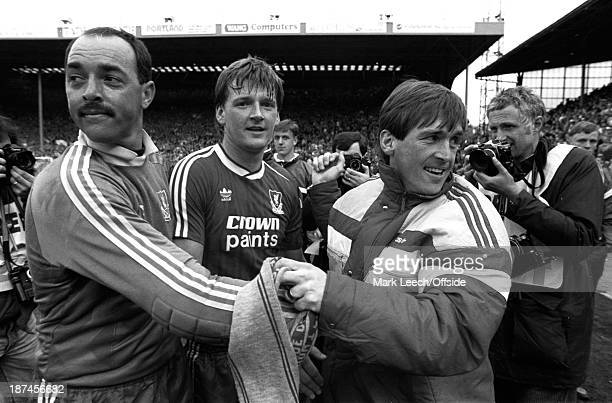 Cup semifinal Hillsborough Liverpool v Nottingham Forest Liverpool manager Kenny Dalglish congratulates players Bruce Grobbelaar and Nigel Spackman...