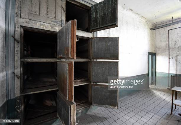 Cupboards remain open in a room in one of the buildings of the The Ellis Island Hospital on August 5 a 750bed facility which treated over 12 million...
