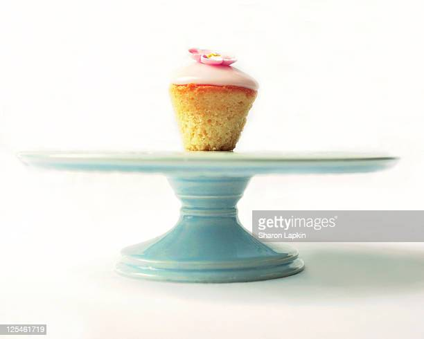 Cupcake on blue ceramic cake stand