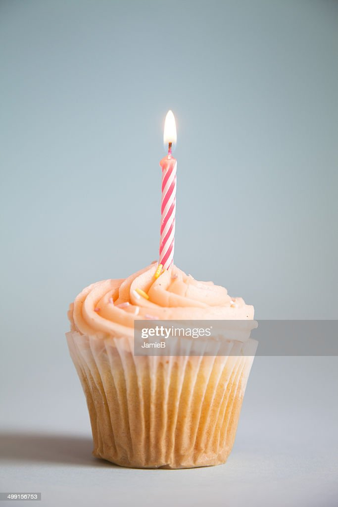 Cupcake with candle : Stock Photo