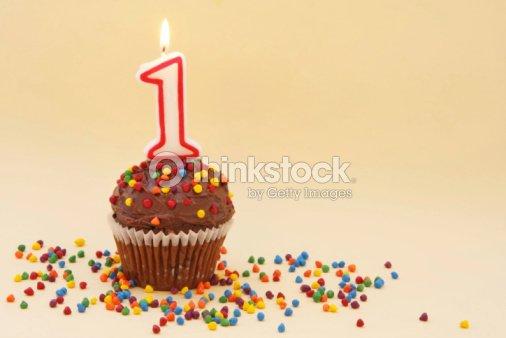 Cupcake con candela numero uno : Foto stock