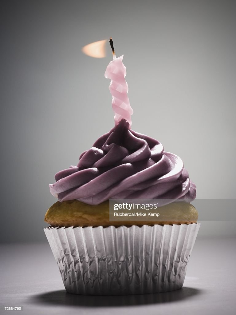 Cupcake with one birthday candle : Stock Photo