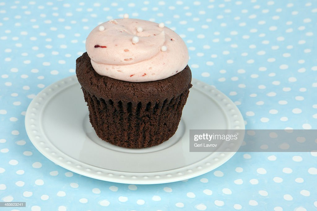 Cupcake with pink frosting : Stock Photo